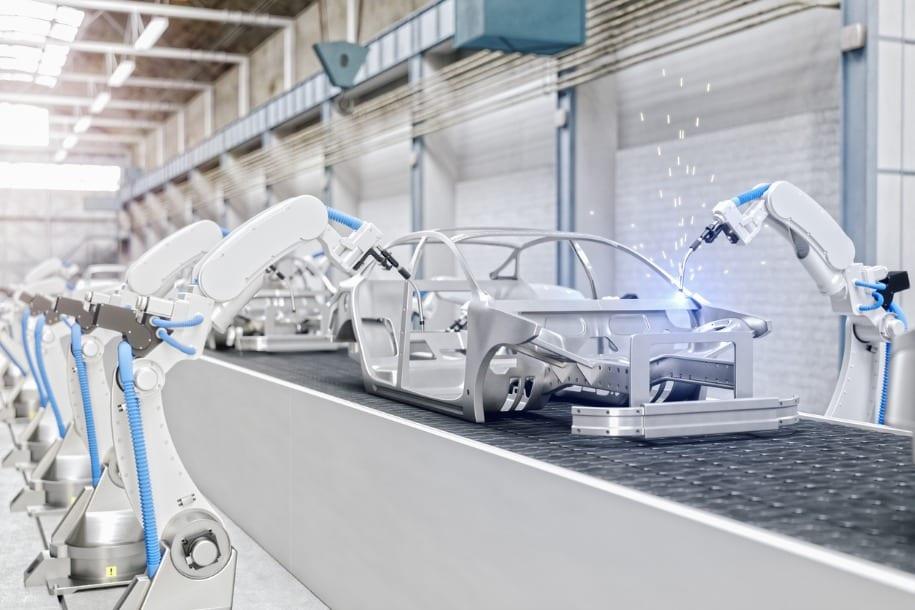 image of car being built on conveyor belt