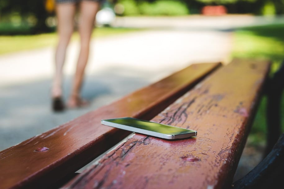 image of phone on park bench