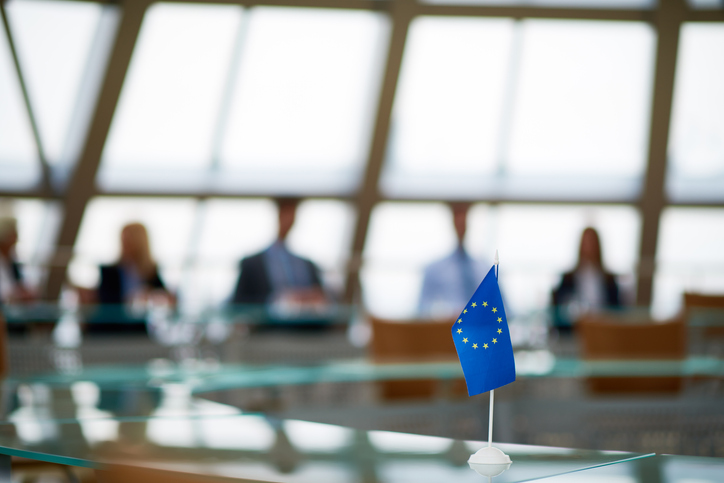 Meeting of European Union in conference room with glassy round table