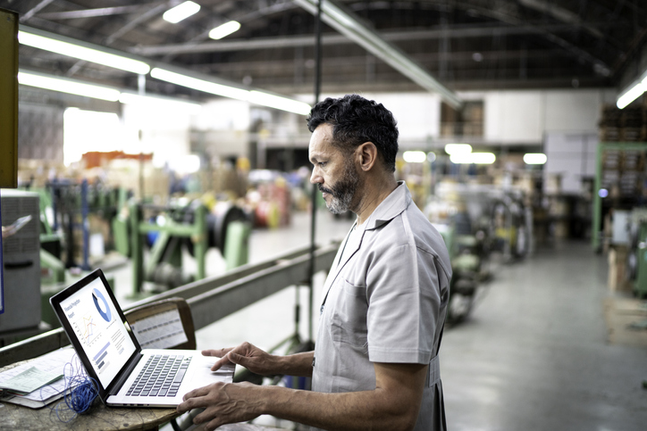 technician using laptop